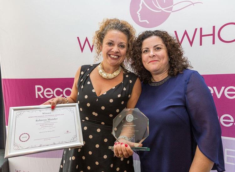 Rebecca winning an award